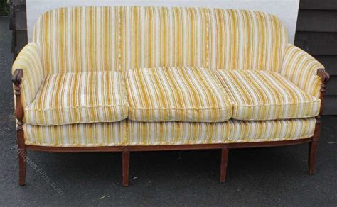 1920 s mahogany framed with spindles gold striped sofa