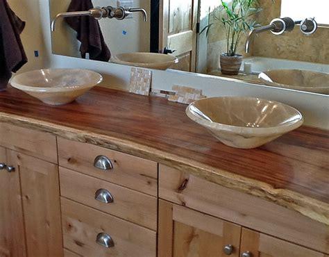 Onyx vessel sinks on natural edge wood slab vanity top contemporary bathroom vanities and