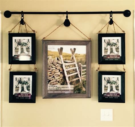 picture frame hanging ideas 25 best ideas about hanging picture frames on pinterest