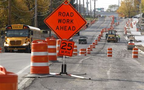 a road in the road working and traveling around the construction zone entitlement itea