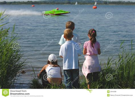 motor boat kid song cute kids at motorboat wm editorial image cartoondealer