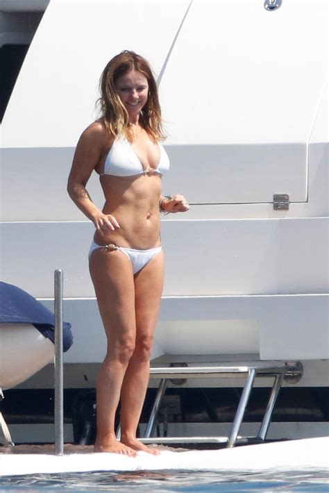 booty bay boat goes to geri halliwell shows off her flat stomach in a white