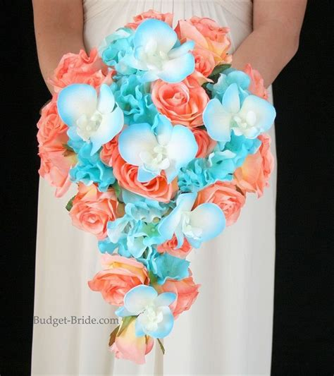 Blue Tipped Flower cascading brides bouquet with coral roses malibu blue