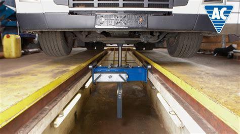 Standard air hydraulic single ram pit jack   YouTube