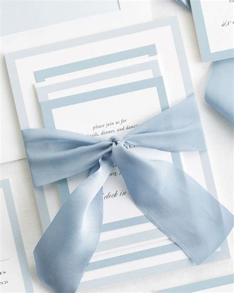 tie ribbon around wedding invitation upscale monogram ribbon wedding invitations ribbon