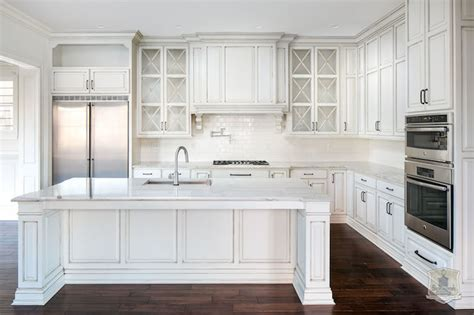 white kitchen with white glazed grid backsplash tiles