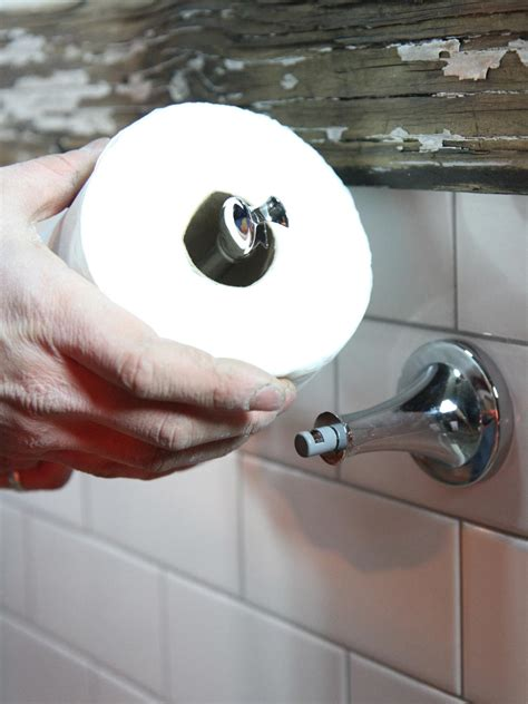 how to hang toilet paper how to install a toilet paper holder how tos diy