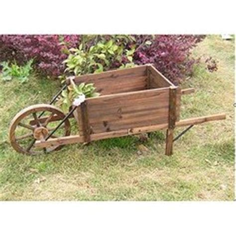 Decorative Wooden Wheelbarrow Planter by Wooden Wheelbarrow Planter Patio Lawn Garden