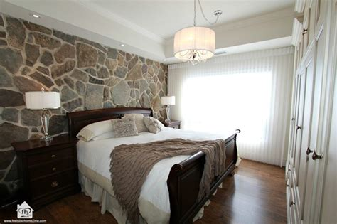 stone wall in bedroom master bedroom with stone wall feature contemporary