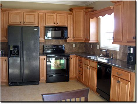 oak kitchen cabinets with black appliances smart home