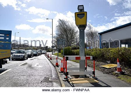 traffic light on red with camera vigilance system on top