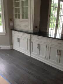 Brown Kitchen Canisters grey wood flooring dining room contemporary with white