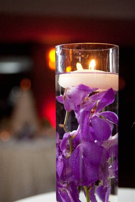 purple floating candles for centerpieces purple flowers floating candles wedding flowers and