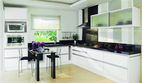 kitchens with white cabinets and black appliances room