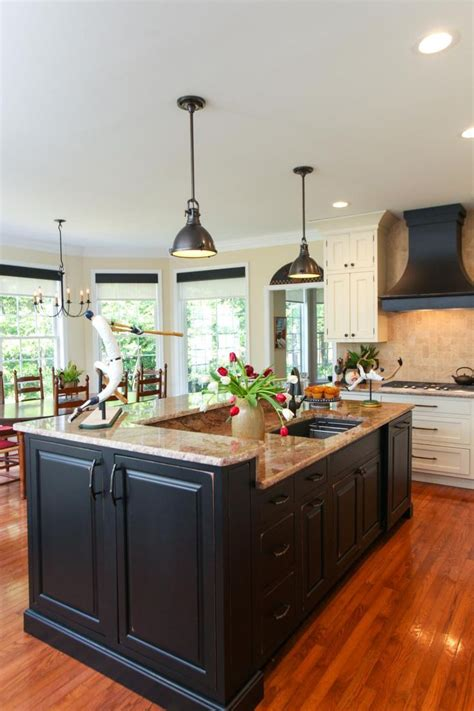 centre islands for kitchens this large center island features black cabinetry and
