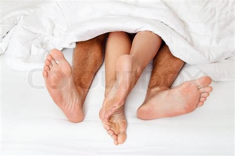 bed feet dier a couple feet in bed love sex and partners stock