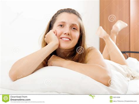 lie on the bed cheerful woman lying in bed stock photo image 35614308