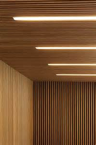wooden ceiling light wood slats add texture and warmth to these homes