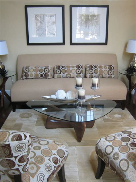 How To Decorate A Glass Coffee Table Small Living Room The Light Earth Tones Open The Room And Along With The Glass Table Make It