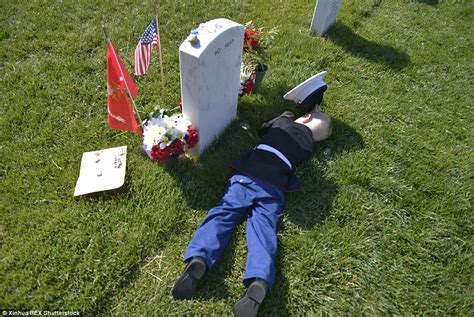 at grave boy in marine lies next to his s grave at arlington national cemetery