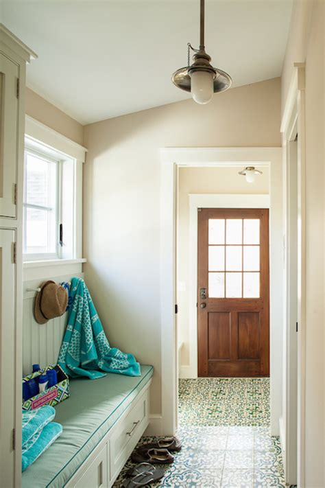 foyer  sloped ceiling cottage laundry room liz levin interiors
