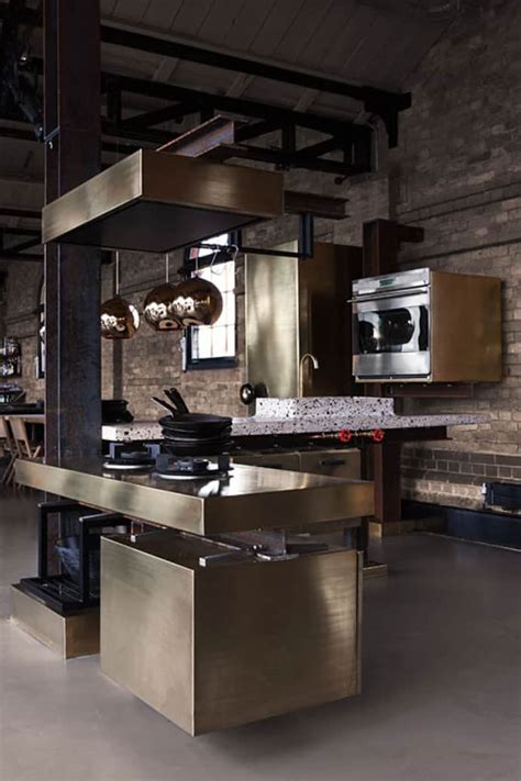 Eat On Kitchen Island by A Kitchen With Industrial Look Designed By Tom Dixon