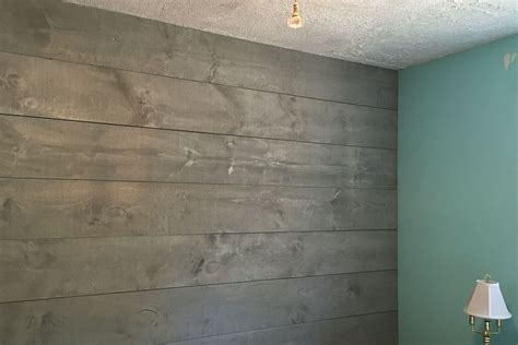 shiplap gray shiplap wall stained in drift wood grey for a coastal feel