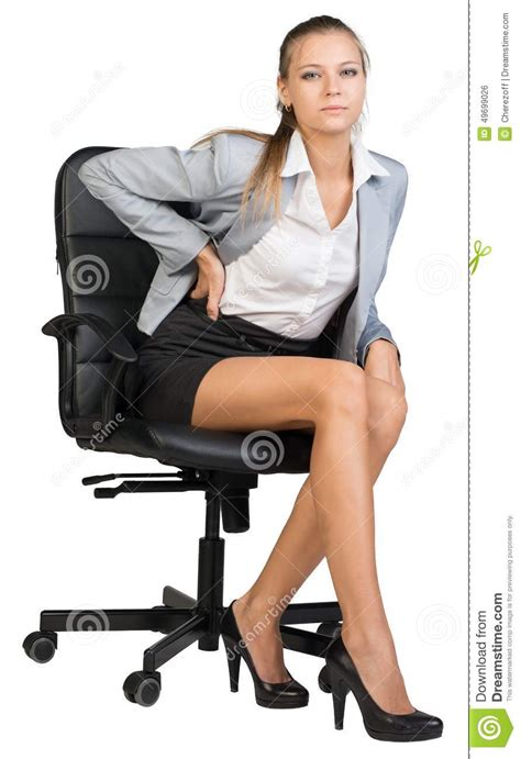 businesswoman with lower back from sitting on stock