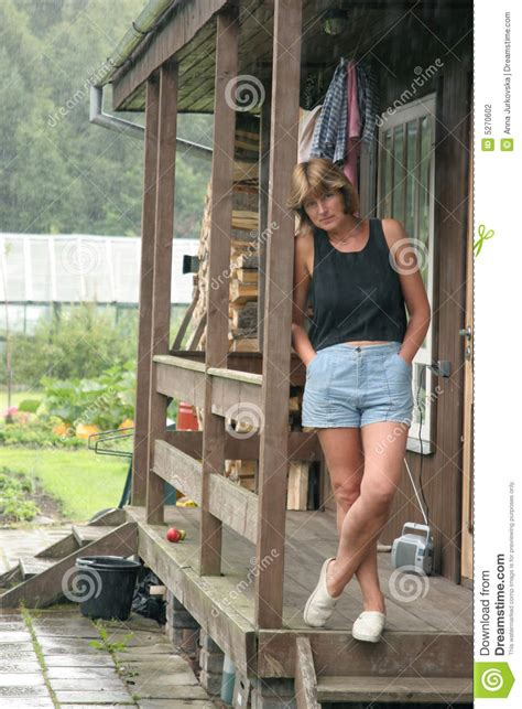 Country Cottage Floor Plans woman on porch of house in the country stock photography