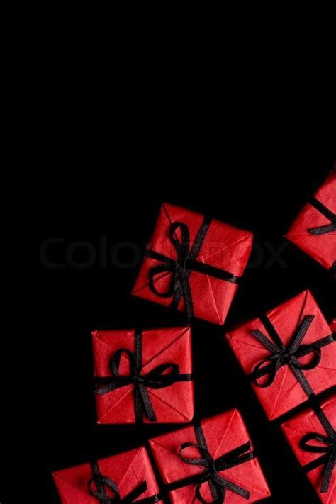 Many red gift boxes on black background   Stock Photo
