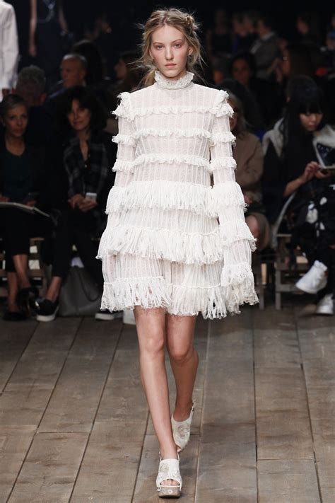 In Runway Looks Frillr Its The Frills That Count by Julianne Looks Leggy At The Hunger Mockingjay