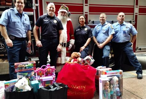 Houston Fire Department Toy Giveaway - giving back holiday toy drives in houston mommy poppins things to do in houston