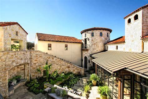 spanish style courtyards horseshoe bay spanish style lake house courtyard by