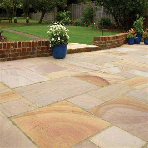 a complete guide on how to lay a patio the garden