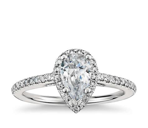 pear shaped halo engagement ring in 18k white gold