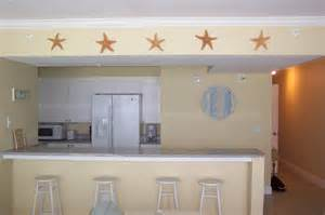 beach themed kitchen canisters coastal condo decorating ideas beach house wall decor