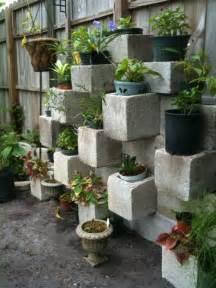 c a y l a w r a l cinder block garden design