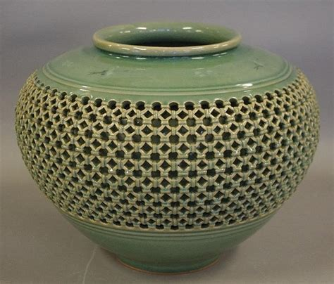 large korean celadon vase with a basket weave and crane deco