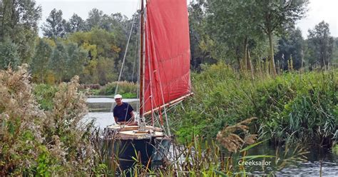 sailing boat on canal creeksailor yacht sailing on canals