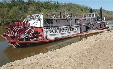 small boat used to tow large vessel rusting ohio paddle wheel towboat faces a tight river
