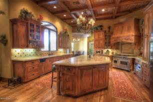 Rustic kitchen with custom copper range hood simple granite counters
