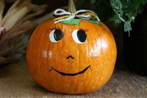 bride and groom decorated pumpkins | lovetoknow