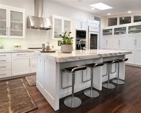 small kitchen island with seating and white granite