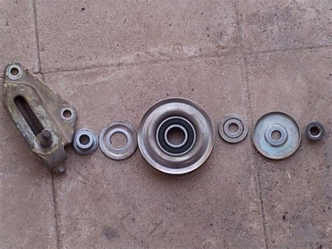 how to replace tensioner pulley 1993 honda sol