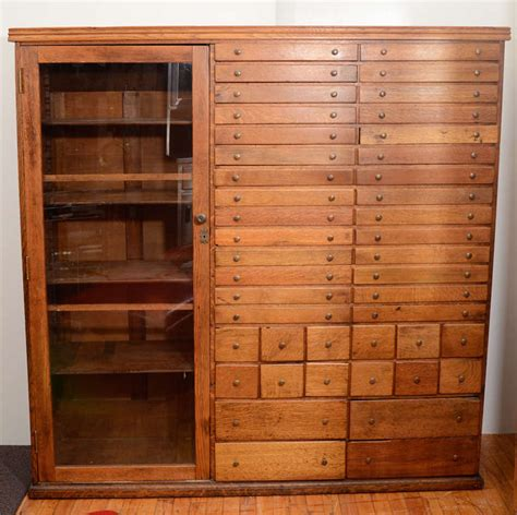elaborate mission apothecary cabinet with 44 drawers at