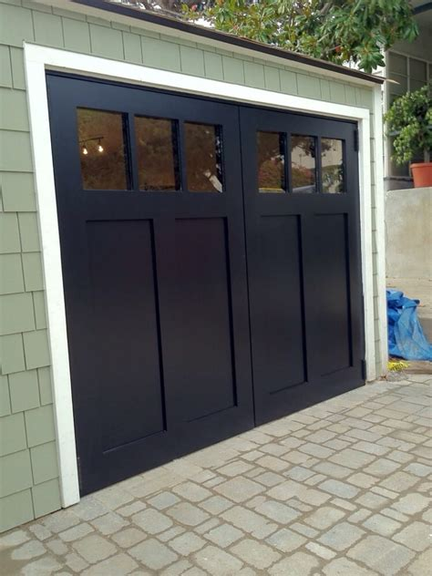 swing carriage garage doors craftsman style swing out carriage garage doors yelp