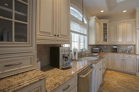 Giallo Ornamental Light Granite White Cabinets by Giallo Ornamental Granite Countertops Pictures Cost