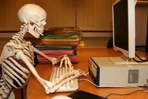 Skeleton At Desk quit wasting time following the