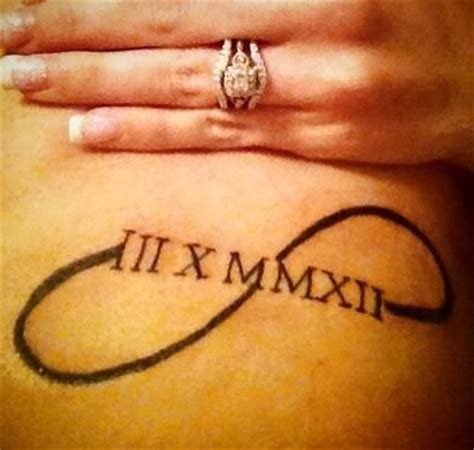 infinity tattoo with roman numerals infinity symbol with wedding date in roman numerals