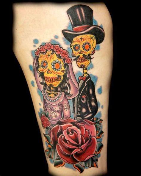 skeleton couple tattoo and groom sugar skulls inked for